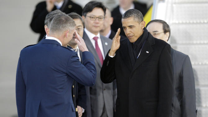 President Barack Obama salutes upon arrival at Osan Air Base to attend the Nuclear Security Summit, in Osan, south of Seoul, South Korea, Sunday, March 25, 2012. (AP Photo/Lee Jin-man)