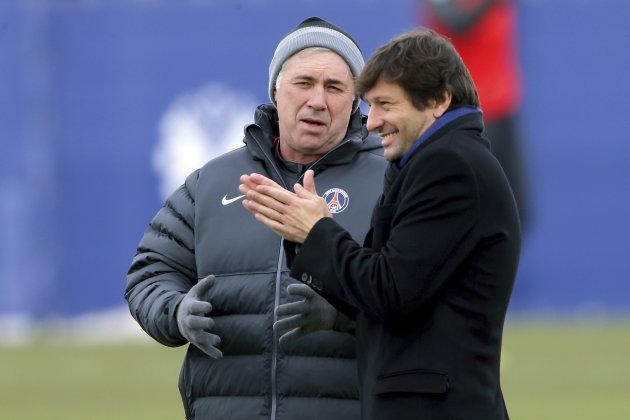 Paris St-Germain sports director Leonardo and coach Carlo Ancelotti attend a training session at the Camp des Loges training center near Paris