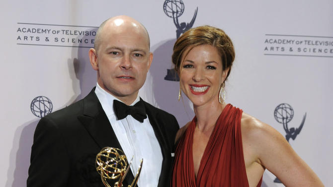 """Rob Corddry and his wife Sandra Corddry pose backstage with the award for outstanding special class: short-format live-action entertainment programs for """"Children's Hospital"""" at the 2012 Creative Arts Emmys at the Nokia Theatre on Saturday, Sept. 15, 2012, in Los Angeles. (Photo by Chris Pizzello/Invision/AP)"""
