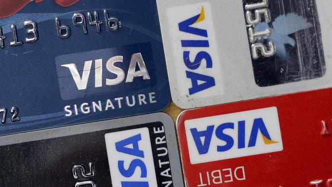 In this April 25, 2013 photo, credit and debit cards are displayed for a photographer in Baltimore. Visa Inc. reports quarterly financial results after the market closes on Wednesday, May 1, 2013. (AP Photo/Patrick Semansky)