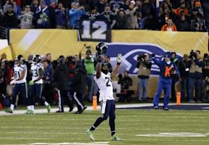 Seattle Seahawks Marshawn Lynch celebrates a teammate's touchdown against the Denver Broncos in the third quarter of the NFL Super Bowl XLVIII football game in East Rutherford