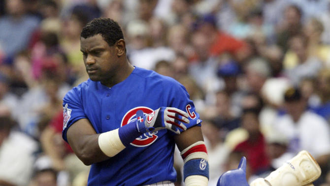 FILE - In this June 18, 2004, file photo, Chicago Cubs' Sammy Sosa tosses his helmet and shin guard after striking out to end the sixth inning against the Oakland Athletics during a baseball game in Chicago. With the cloud of steroids shrouding many candidacies, baseball writers may fail for the only the second time in more than four decades to elect anyone to the Hall. (AP Photo/Nam Y. Huh, File)