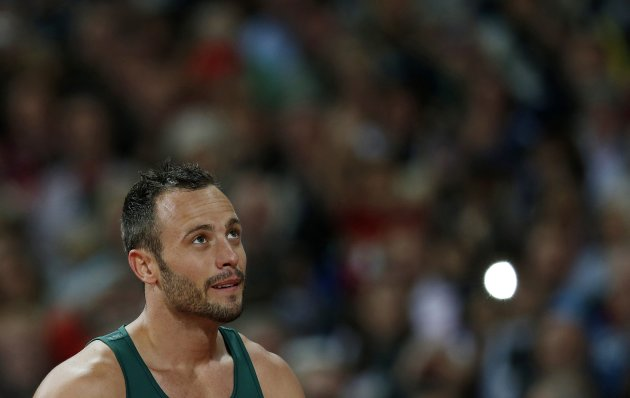 File photo of Pistorius arriving on the track before his men's 200m T44 classification heat at the Olympic Stadium at the London 2012 Paralympic Games