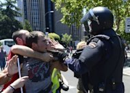 Demonstrators clash with riot policemen during a miners' demonstration in Madrid. Spain's Prime Minister Mariano Rajoy announced Wednesday a 65-billion-euro austerity package to avert financial collapse as protesters against mining cuts clashed with police
