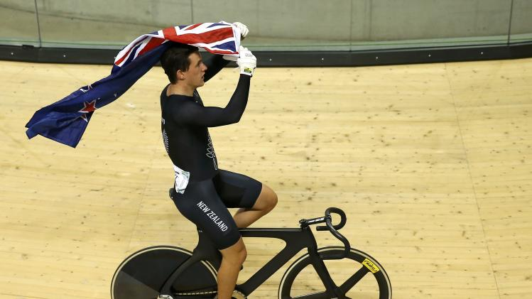 New Zealand's Webster celebrates after winning the men's sprint finals cycling race at the 2014 Commonwealth Games in Glasgow