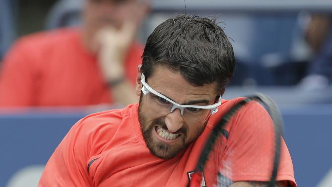 Janko Tipsarevic of Serbia returns a shot during his win over Germany's Phillip Kohlschreiber in the fourth round of play at the 2012 US Open tennis tournament,  Wednesday, Sept. 5, 2012, in New York. (AP Photo/Mike Groll)