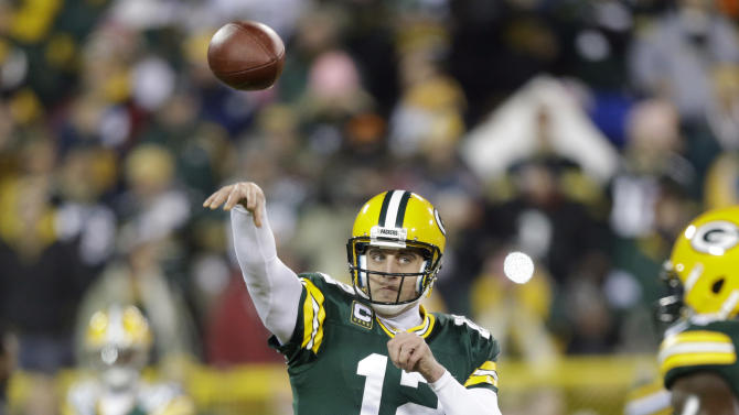 Green Bay Packers quarterback Aaron Rodgers warms up before an NFL wild card playoff football game against the Minnesota Vikings Saturday, Jan. 5, 2013, in Green Bay, Wis. (AP Photo/Jeffrey Phelps)