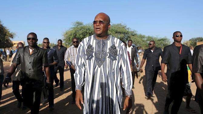 File photo of Roch Marc Kabore arriving to vote during the presidential and legislative election at a polling station in Ouagadougou