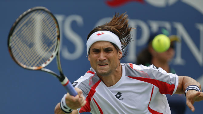 Spain's David Ferrer returns a shot against Janko Tipsarevic of Serbia in the quarterfinals during the 2012 US Open tennis tournament,  Thursday, Sept. 6, 2012, in New York. (AP Photo/Julio Cortez)