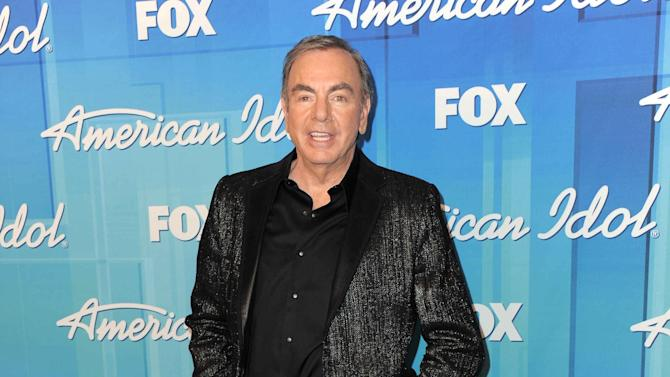"""Neil Diamond poses backstage at the """"American Idol"""" finale on Wednesday, May 23, 2012 in Los Angeles. (Photo by Jordan Strauss/Invision/AP)"""