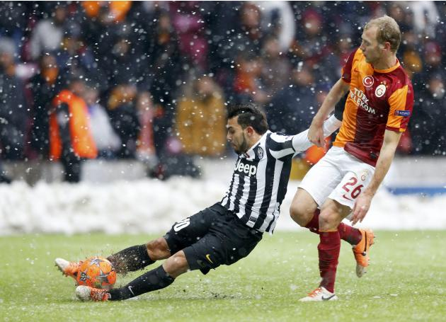 Tevez of Juventus challenges Kaya of Galatasaray during their Champions League soccer match in Istanbul
