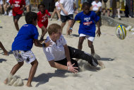 Britain's Prince Harry plays rugby at Flamengo's beach in Rio de Janeiro, Brazil, Saturday March 10, 2012. Harry is in Brazil at the request of the British government on a trip to promote ties and emphasize the transition from the upcoming 2012 London Games to the 2016 Olympics in Rio de Janeiro. The prince began Saturday teaching tag-rugby to children and taking beach volleyball lessons. (AP Photo/Felipe Dana)