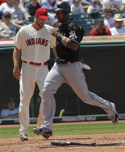 Johnson helps Marlins take 2 of 3 from Indians