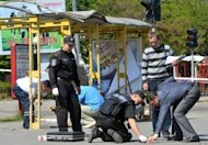 Police bomb experts examine a blast site in Dnipropetrovsk, eastern Ukraine, in April 2012. An outraged Ukraine on Tuesday hit back at the British media, current and former footballers for urging fans to stay away from next month's Euro 2012 tournament over fears of racism and violence in the ex-Soviet state