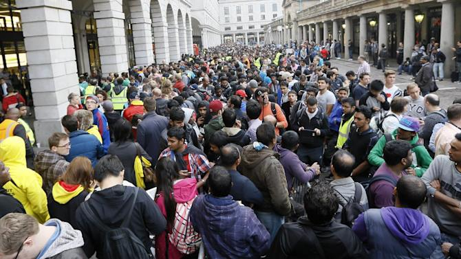 People queue outside an Apple shop in London, Friday, Sept. 19, 2014. The new Apple iPhone 6 went on sale at the shop on Friday. (AP Photo/Kirsty Wigglesworth)