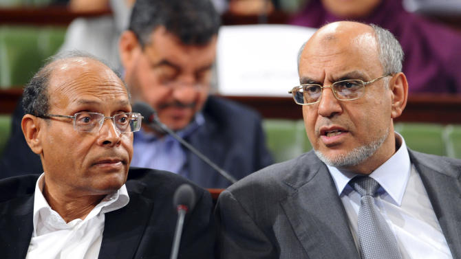 FILE -  President of Tunisia who is a veteran rights activist Moncef Marzouki, left, and Prime Minister Hamadi Jebali, right, attend a session at the newly elected assembly, near Tunis, in this Wednesday, Nov. 23, 2011 file photo, as they began the yearlong process of shaping a constitution and their democratic future.  It is reported Friday Sept. 7, 2012, that differences over how to word the country's constitutional document are threatening to tear apart the ruling alliance of secular and religious parties. (AP Photo/Hassene Dridi, File)