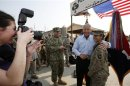 U.S. Secretary of Defense Chuck Hagel poses for a picture with a member of the U.S. 101st Airborne Division during his visit to Jalalabad Airfield in eastern Afghanistan