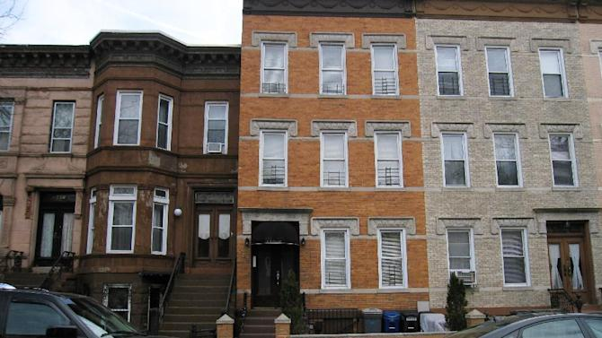 """This April 7, 2013 image shows a building on MacDonough Street in the Bedford-Stuyvesant section of Brooklyn where Jackie Robinson and his wife Rachel lived during his 1947 rookie season with the Brooklyn Dodgers. A new movie, """"42,"""" tells Robinson's inspiring story as the man who integrated Major League Baseball. Although much of the movie was filmed in the South, some scenes were shot on MacDonough because the filmmakers could not find a building elsewhere with the distinctive front stoop commonly found in Brooklyn.  (AP Photo/Beth J. Harpaz)"""