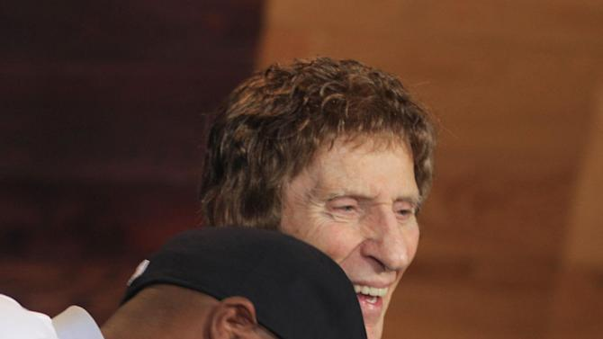 Detroit Tigers outfielder Torii Hunter laughs with owner Mike Ilitch during a news conference in Detroit, Friday, Nov. 16, 2012. Hunter, who last played for the Los Angeles Angels, signed a two-year, $26 million deal. (AP Photo/Carlos Osorio)