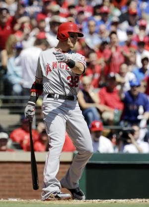 Los Angeles Angels' Josh Hamilton strikes out against Texas Rangers pitcher Derek Holland during the second inning of a baseball game, Friday, April 5, 2013, in Arlington, Texas. (AP Photo/Tony Gutierrez)