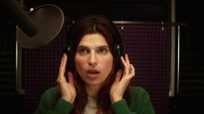 """This publicity photo released by Roadside Attractions shows Lake Bell in a scene from the film """"In a World...,"""" a comedy about a struggling voice coach. Written and directed by Bell, who also stars in the film, it won the Sundance 2013 Waldo Salt Screenwriting Award for the script. Real voice-over artists, the men and women who've spent years invisibly announcing the latest Taco Bell temptation, the promise of Firestone tires or upcoming Lifetime programs, who've seen the film (which expands to more than 30 locations Aug. 16, 2013) say it's great to watch their profession on screen. (AP Photo/Roadside Attractions, Seamus Tierney)"""