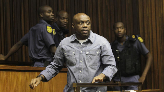 Nigerian terror suspect Henry Okah, in court in Johannesburg Monday, Jan. 21, 2013. Okah was found guilty of masterminding twin car bombings during independence celebrations in October 2010 in Nigeria killing at least 12 people and wounding three dozen. (AP Photo)