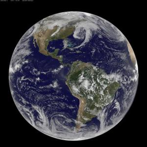 Satellite image shows the low pressure systems in the eastern Pacific Ocean, over the United States' Heartland, and in the eastern Atlantic Ocean