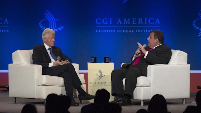 "New Jersey Gov. Chris Christie, right, speaks while former President Bill Clinton listens during the Clinton Global Initiative America's meeting in Chicago, Friday, June 14, 2013. Clinton and Christie held a closing session titled ""Cooperation and Collaboration: A Conversation on Leadership."" (AP Photo/Scott Eisen)"