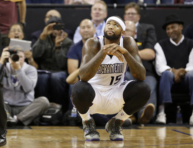 Sacramento Kings  center DeMarcus Cousins looks up at the scoreboard after being called for his sixth foul  and final foul during the fourth quarter against Brooklyn Nets in an NBA basketball game in