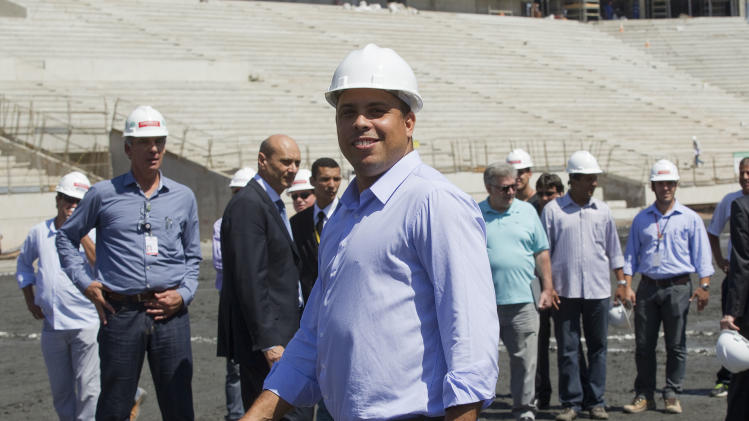 Ronaldo, Brazil's former soccer player and a member of the local organizing committee for the 2014 World Cup visits the Corinthians' stadium, which is under construction and will host the opening match of the World Cup in 2014 in Sao Paulo, Brazil, Wednesday, Nov. 28, 2012. Officials are revising the construction work being done at stadiums ahead of the Confederations Cup soccer tournament in 2013 and the 2014 FIFA World Cup soccer tournament. (AP Photo/Andre Penner)