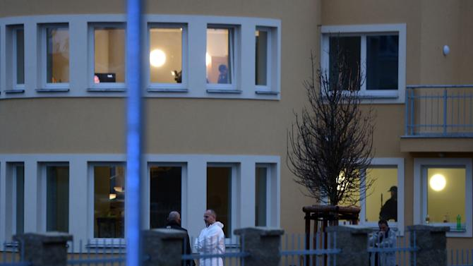 Investigators observe the situation in the residence of Palestinian ambassador to the Czech Republic Jamal Al Jamal, who has died after an explosion in his diplomatic flat in Prague-Suchdol on Wednesday, Jan. 1, 2014. (AP Photo/CTK, Katerina Sulova) SLOVAKIA OUT