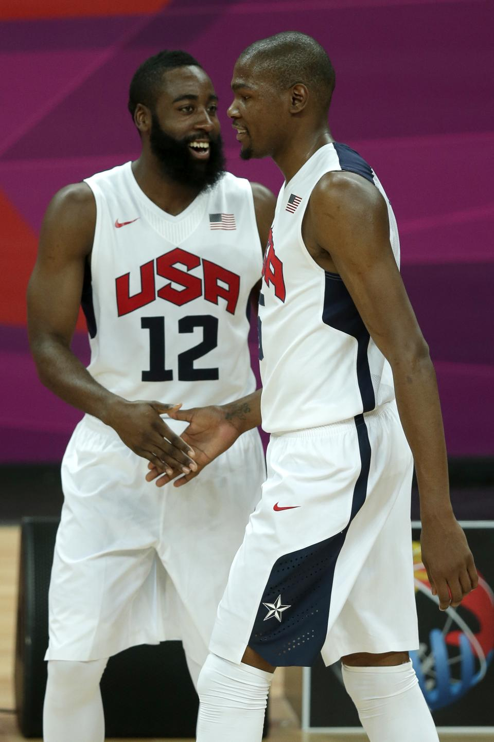 United States players James Harden (12) and Kevin Durant celebrate a basket during a men's basketball game against Nigeria at the 2012 Summer Olympics, Thursday, Aug. 2, 2012, in London. (AP Photo/Charlie Riedel)
