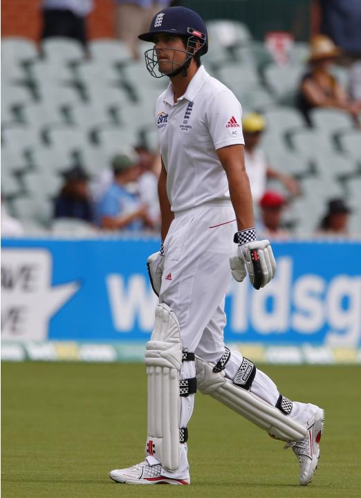 England's captain Cook walks off the field after his dismissal during the fourth day's play in the second Ashes cricket test against Australia at the Adelaide Oval
