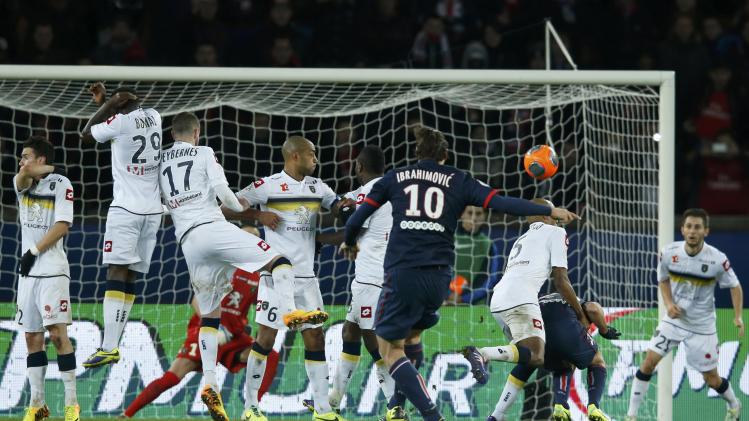 Paris St Germain's Zlatan Ibrahimovic shoots a free kick to score goal against FC Sochaux during their French Ligue 1 soccer match at the Parc des Princes Stadium in Paris