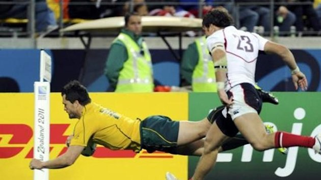 Wallabies' Adam Ashley-Cooper scores a try during their Rugby World Cup Pool C match
