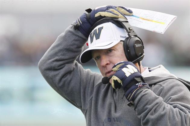 Winnipeg Blue Bombers' head coach Tim Burke adjusts his headset during the first half of their CFL game against Montreal Alouettes in Winnipeg on Saturday, November 3, 2012. The Toronto Argonauts