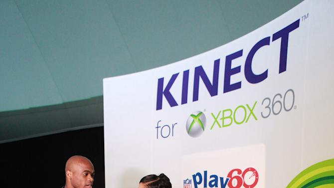 NFL running back Adrian Peterson and E! News Alicia Quarles make an appearance playing Kinect for Xbox 360 with kids, on Thursday, Jan. 31, 2013 in New Orleans, LA. (Photo by Barry Brecheisen/Invision for Xbox/AP Images)