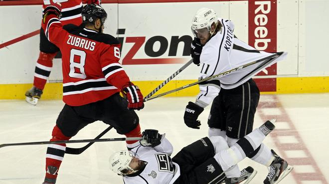 Dainius Zubrus #8 Of The New Jersey Devils Fights For A Loose Puck With Justin Williams #14 And Anze Kopitar #11 Of  Getty Images