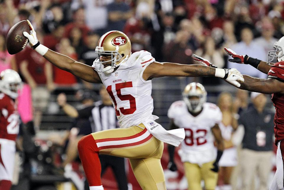 San Francisco 49ers wide receiver Michael Crabtree (15) scores a touchdown against the Arizona Cardinals during the first half of an NFL football game, Monday, Oct. 29, 2012, in Glendale, Ariz. (AP Photo/Ross D. Franklin)