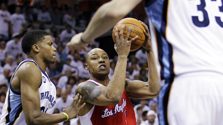 Los Angeles Clippers' Caron Butler, center, works the ball around Memphis Grizzlies' Rudy Gay, left, and Marc Gasol (33), of Spain, during the first half in Game 1 of a first-round NBA basketball playoff series, Sunday, April 29, 2012, in Memphis, Tenn. (AP Photo/Danny Johnston)