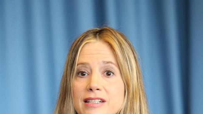"US actress Mira Sorvino, a UN Goodwill Ambassador to combat human trafficking for the United Nations Office on Drugs and Crime, UNODC, speaks during an interview by the Associated Press at the United Nations in Vienna, Austria, Friday, Feb. 8, 2013. ""I love acting and that is my job right now,"" Sorvino says. At the same time, she describes her advocacy against human trafficking and modern-day slavery as ""my calling,"" and so important that ""in a decade or so, I wouldn't mind just switching to a career in humanitarian causes."" (AP Photo/Alexander Mueller)"