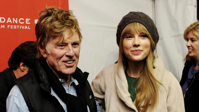 """FILE - In this Jan. 20, 2012 file photo, Robert Redford poses with singer Taylor Swift at the premiere of the documentary film """"Ethel"""" at the 2012 Sundance Film Festival in Park City, Utah. (AP Photo/Chris Pizzello, File)"""