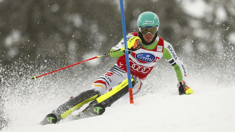 Neureuther of Germany clears a pole during the first run of the men's slalom competition at the FIS Alpine Skiing World Cup Finals in Lenzerheide