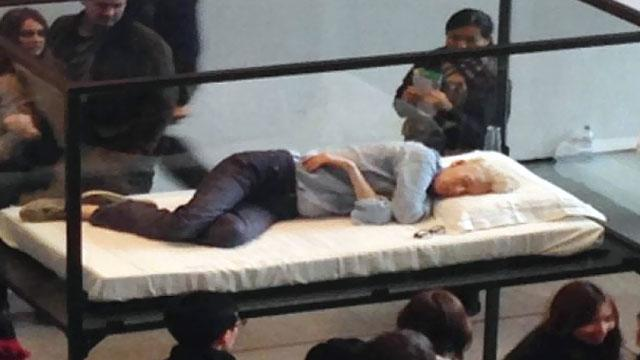 Tilda Swinton Naps In Glass Box at MOMA
