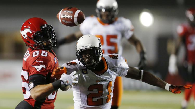 Calgary Stampeders' Parker tries to catch a pass in front of BC Lions' Phillips during their CFL football game in Calgary