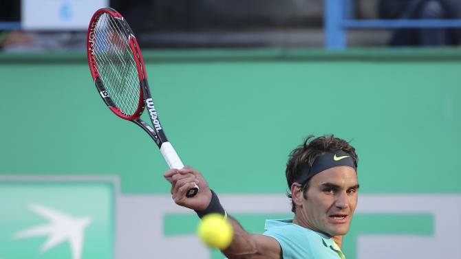 Roger Federer of Switzerland plays against  Pablo Cuevas of Uruguay during the final match of the Istanbul Open tennis tournament at Garanti Koza Arena in Istanbul, Turkey, Sunday, May 3, 2015. Federer won the final match of the Istanbul Open, the first ever ATP World Tour event in Turkey. (AP Photo)