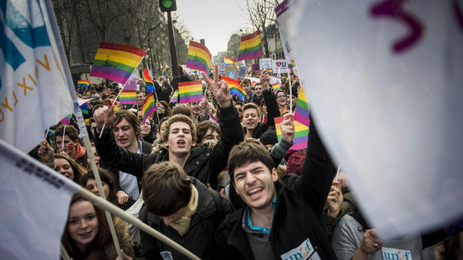 People demonstrate for a government project to legalize same-sex marriage and adoption for same-sex couples in Paris, France, Sunday, Jan. 27, 2013. (AP Photo/Benjamin Girette)