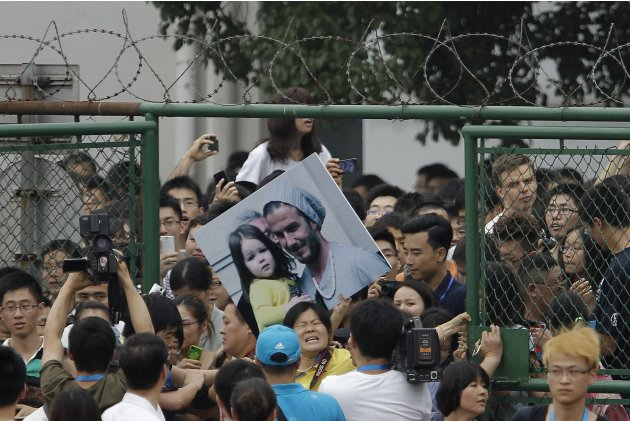 Fans of former England captain David Beckham try to break into a soccer field at Tongji University in Shanghai