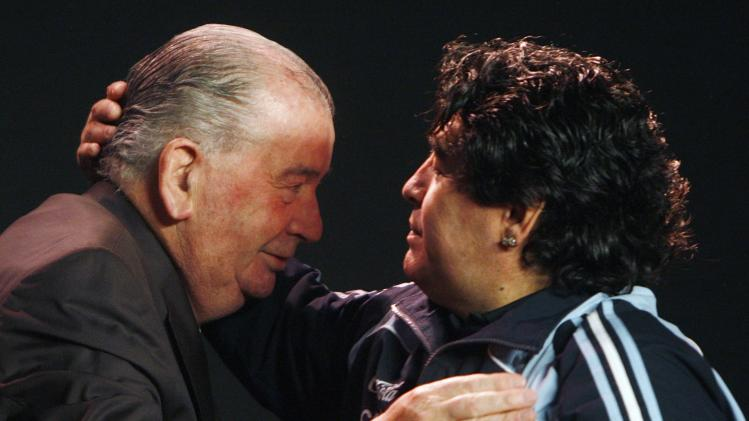 File photo of Argentina's former soccer player Diego Maradona embracing Argentina Football Association (AFA) President Julio Grondona at AFA's headquarters in Ezeiza