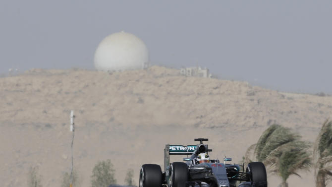 Mercedes driver Lewis Hamilton of Britain steers his car during the third free practice ahead of the Bahrain Formula One Grand Prix at the Formula One Bahrain International Circuit in Sakhir, Bahrain, Saturday, April 18, 2015. The race will take place on Sunday. (AP Photo/Luca Bruno)